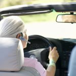 photo of a woman driving with bluetooth