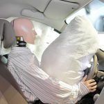 Picture of deployed airbag and stunt dummy