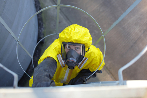 photo of a worker in a hazmat suit