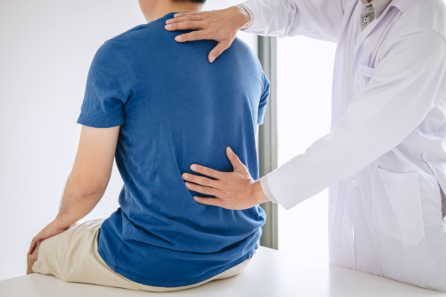 Picture of doctor checking patient's back