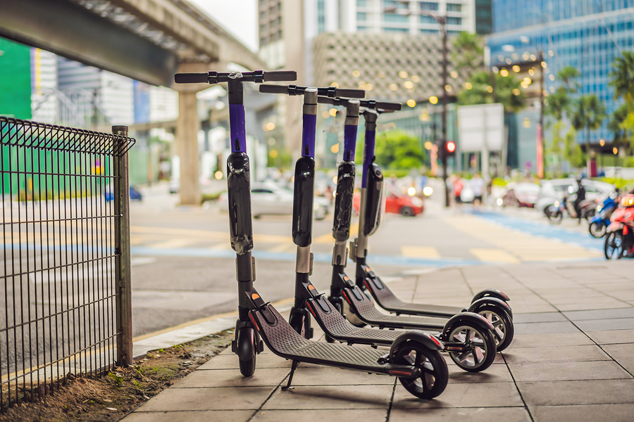 Electric scooters lined up on street