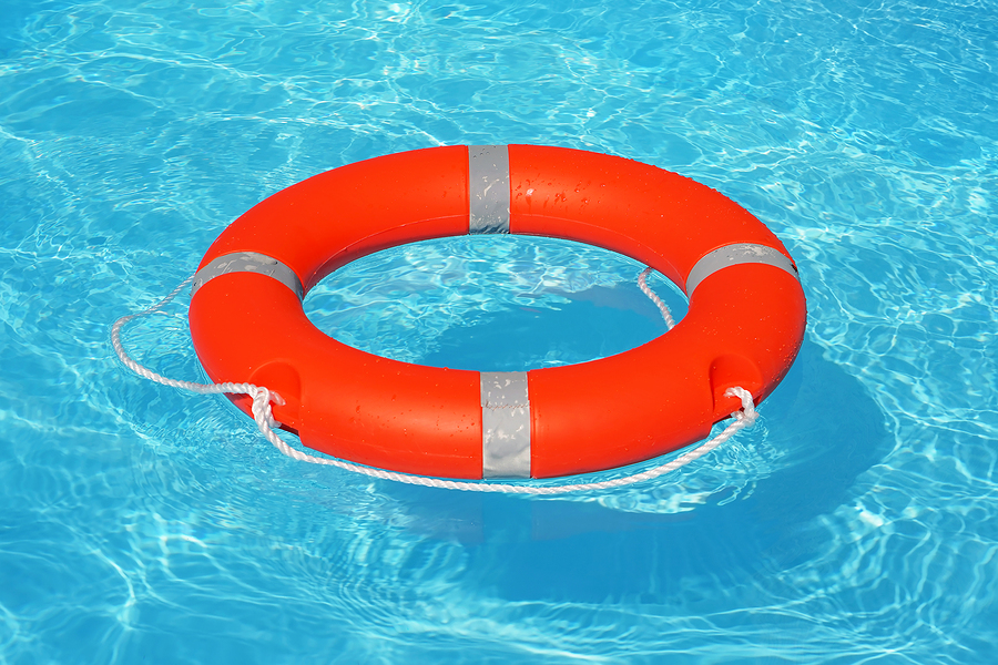 Orange lifebuoy in water