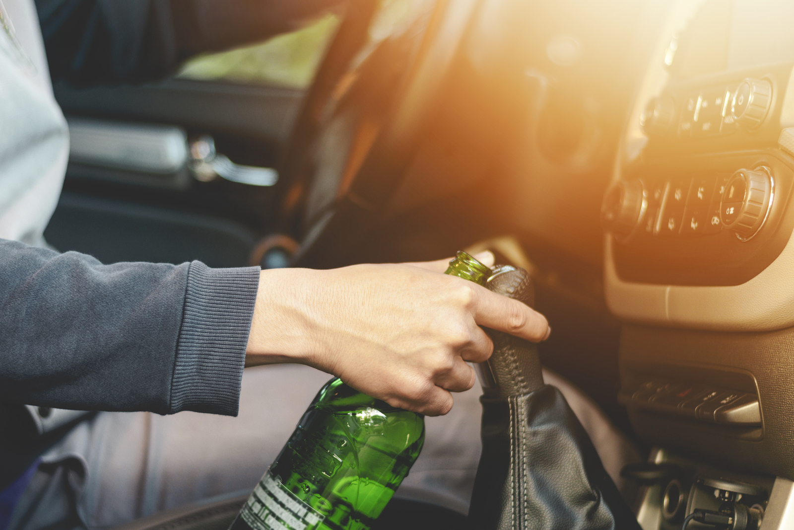 Person drinking and driving